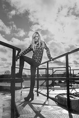 Into the sun (cowboy72) Tags: blackandwhite beautiful beauty rooftops boots blonde rails heels intothesun markelsworthphotography contrajoir