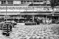 Finger Signing from a Distance (Pauls-Pictures) Tags: street camera city people urban blackandwhite sun man men public monochrome sign square lens photography peace fuji shadows finger candid fingers sydney streetphotography australia giving fujifilm standard streetphotos parramatta streetpics streetphotograhy achromatic xt1 streetpictures ausrralia 35nmf14lens