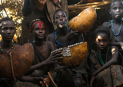 Circumcised boys from the dassanech tribe staying together until they are healed, Omo valley, Omorate, Ethiopia (Eric Lafforgue) Tags: africa people color men boys coffee horizontal outdoors togetherness necklace day african traditional young ceremony culture teenagers tribal indoors hut dime teenager blackpeople bead omovalley ritual ethiopia tribe circumcision groupofpeople dimi initiation manhood hornofafrica eastafrica circumcised animalskin abyssinia tribesmen omorate indigenousculture geleb dassanech calabashes dassanetch daasanach daasanech blackethnicity ethio161875