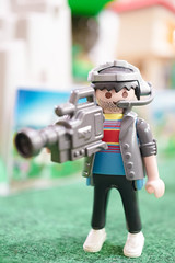 BANGKOK - MAY 7, 2016 : Playmobil cameraman wearing headset with microphone and broadcast equipment is recoding the outdoor event. Cameraman occupation and career concept (enchanted.fairy) Tags: