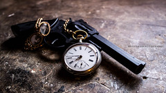 Time And Death (Morpheus Photography) Tags: life wood old shadow black vintage movie death gold still time watch weapon pistol revolver