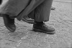 walk throgh paris (svenja_i) Tags: street girls people blackandwhite holiday paris france walking geotagged movement frankreich shoes pants boots centre visit traveller cobblestone human fabric stadt bewegung cloth pompidou laces greyscale citytrip kopfsteinpflaster placegeorges