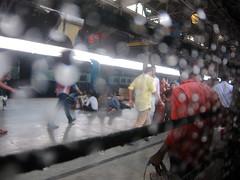 Monsoon maze (Rajib Singha) Tags: street travel people india abstract rain train interestingness bokeh platform flickriver canonpowershots90 howrahstnwestbengal