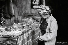 Taking some money (andrawayan) Tags: old bw bali woman film indonesia market traditional fujifilm balinese collor x100s