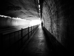 alone in the tunnel (Sandy...J) Tags: street city light shadow urban bw sunlight white man black lines silhouette wall germany dark underpass walking munich mnchen bayern deutschland photography mono licht blackwhite noir alone fotografie darkness walk wand streetphotography atmosphere tunnel olympus stadt sw mann monochrom passage atmosphre mauer bavarian gegenlicht dunkelheit unterfhrung linien spazieren allein durchgang sonnenlicht schwarzweis strase strasenfotografie