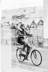 Looking through the Glass (Charlie Mike Photography) Tags: street windows people man art netherlands bicycle nederland ramen workshop portret fiets leeuwarden straatbeeld mensen muurschildering straatfotografie