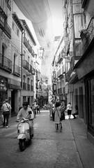 Verano castellano (Alexis Lecoq) Tags: street old city summer espaa white black monochrome vintage spain vespa streetphotography center scene toledo historical timeless castilla