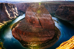 Horseshoe Bend (addddee) Tags: trip travel blue arizona usa sun color colour art colors canon river landscape saturated rocks colours bend sigma sunny page coloradoriver flare horseshoe t3 sunflare 1835 rockformation horseshoebend pagearizona sigma1835 arizonausa artlens canont3 sigmaartlens