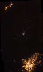 Pyongyang Surrounded by Darkness (sjrankin) Tags: china panorama russia edited nasa seoul citylights southkorea iss rok northkorea pyongyang dprk seaofjapan koreanpeninsula iss043 iss043e40328 iss043e40329 iss043e40330 iss043e40331 31march2015
