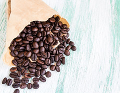 Roasted coffee beans in paper bags on wooden background (DomDew_Studio) Tags: food brown white macro coffee closeup breakfast dark studio cafe beans healthy energy raw flavor natural drink background group beverage grain seed nobody fresh roast gourmet health pile bow espresso caffeine aromatic heap addiction freshness roasted aroma paperbag arabica ingredient coffeebeans