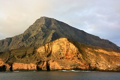 Cruising past a western Island in the Galapagos. (One more shot Rog) Tags: sea nature volcano scene cliffs galapagos volcanoes volcanicisland volcanic mountans mountainous thegalapagosislands thegalapagos rogersargentwildlifephotography
