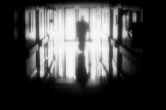 going to the light (moetsj) Tags: light people bw white black monochrome person photography lomo lomography noir fotografie dream hallway creepy odd vignetting et zwart wit vignette blanc droom bulding lomografie photografie vignet réve dreamly
