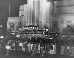 Warner Bros. Beverly Hills (jericl cat) Tags: history vintage paper marquee photo losangeles neon theatre ephemera warner beverlyhills artdeco premiere bros wilshire preview bettedavis theoldmaid