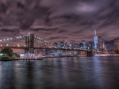 red thunder (Wizard CG) Tags: new york city longexposure bridge sky cloud lake ny building water skyline architecture brooklyn night clouds buildings river landscape evening seaside rocks cityscape waterfront view state bright outdoor manhattan side cities structure shore empire serene hudson epl7