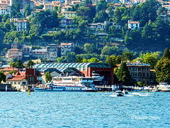 Sunny day on the water (alessiochiolo) Tags: city blue trees light italy sun mountain lake como hot reflection green art nature wet water colors beautiful beauty sunglasses landscape boats lago happy photography boat intense italian italia day waves driving ship natural good earth walk air awesome like sunny natura best explore repair lands lovely sole goodmorning colori luxury luce paesaggio battello citt onde officina navigate waterscape giorno cantiere lungo