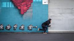 Run and Shoot (Theen ...) Tags: door art girl silver project lumix paintings cyan magenta murals fringe running jeans figure roller shooting annabel chasing pixelated theen kenttown corruatediron littlerundlestreet electronicpellets