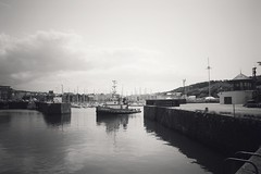 Heading Into Port (Charlie Little) Tags: bw boats nikon seascapes harbour cumbria whitehaven d7100
