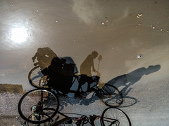 Struggle for life (Aranya Ehsan) Tags: life street shadow sky people sun color reflection water colors rain wheel day ngc lifestyle strength dailylife rickshaw bangladesh struggle
