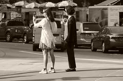 Sightseers or Sidewalk Critics, Columbus Circle (sjnnyny) Tags: nyc urban traffic columbuscircle observing twowomen nylife stevenj manhattanstreets iphonephotographer pentaxk5iis sjnnyny jadednewyorkers
