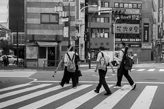 assets (edwardpalmquist) Tags: road street city travel boy people urban blackandwhite man building monochrome japan architecture tokyo backpack crosswalk