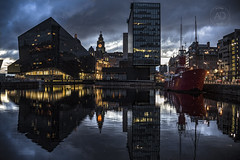 The mann is in a mood! (alun.disley@ntlworld.com) Tags: weather skyline architecture clouds liverpool reflections mood cityscape dusk ships officebuildings clocktower businesses liverbuilding residentialproperty canningdock kathleenandmay mannisland portsandharbours liverpoolwaterfront