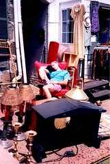 Ellicott City shop called Trade Winds, May 4, 1997. (A CASUAL PHOTGRAPHER) Tags: sleeping maryland howardcounty ellicottcity shopkeepers historictowns merchdise