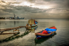 Izmir (Nejdet Duzen) Tags: trip travel sea reflection turkey boat jetty trkiye deniz iskele sandal warship izmir yansma turkei seyahat kayk inciralt savagemisi