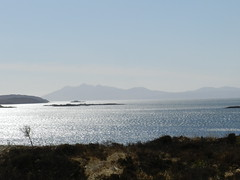 Island of Rum from the Island of Skye, April 2016 (allanmaciver) Tags: sun mountain west skye silhouette island coast scotland small rum loch shining isles simmering cuillin eishort allanmaciver