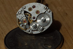Cufflink and Coin (steve_whitmarsh) Tags: money macro art metal closeup macromonday smallerthanacoin