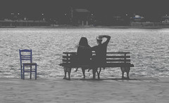 The blue chair and love (Argyro...) Tags: blue people blackandwhite love monochrome bench chair couple hugs