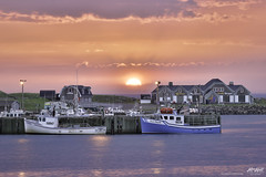 Strawberry Sunset in the Rain (Rob Romard) Tags: ocean sunset clouds boats strawberry capebreton cabottrail
