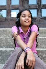 157295087 (dougschneiderphoto) Tags: 1011years 1213years armscrossed aspirations blackhair bracelet child colorimage day daydreaming dominicanethnicity dreams female headphones latinamericanandhispanicethnicity listening littlegirls longhair lookingaway music oneperson outdoors pink poloshirt shirt sitting smiling steps summer vertical