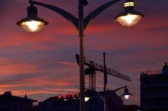 Soir raphalite (Jean-Luc Lopoldi) Tags: crpuscule twilight ciel lampadaires nuagesroses pinkclouds lumire light grue crane enseigneaunon neonsign hotel ctedazur saintraphael