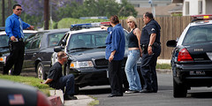 Under Arrest (Chris Yarzab) Tags: woman white man male female clyde custody scene prison criminal crime jail blonde bonnie activity incident arrest investigation officers detectives handcuffed
