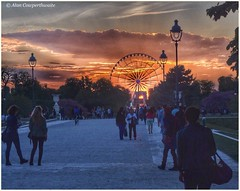 The one day of the year when the sun sets in the middle of the Arc de Triomphe, and there's a big wheel blocking the view! (alcowp) Tags: park sunset paris france tourism weather wheel clouds tuileries arcdetriomphe parc granderoue