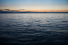 silence (JuNu_photography) Tags: blue sunset sea art 35mm waves quiet 14 smooth sigma wave calm baltic scandinavia waterscape