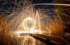 My god, it's full of sparks. (HS_Burnum) Tags: sea sky lake reflection wool water night stars lost fire star see pier reflex wasser long exposure glow place nacht steel trails himmel ring spinning nikkor sparks stern feuer spiegelung viele funken viel afs reflektion steg sterne mirroring langzeitbelichtung d300 leuchten drehen stahlwolle 1685mm projekt2016 projekt2016april
