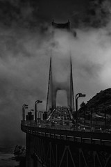 Foggy memory (JohnNguyen0297) Tags: ocean sf sanfrancisco california bridge summer fog contrast canon lowlight mood traffic suspension foggy silhouettes goldengatebridge goldengate drama suspensionbridge bnw atmospheric t3i fogtography johnnguyen0297
