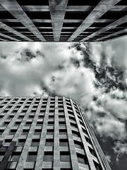 Looking upward to the sky (cosmosushi) Tags: street city trip travel sky bw cloud sun white black building geometrico glass skyline architecture modern clouds skyscraper blackwhite phone erasmus russia geometry moscow edificio shapes sunny minimal lookup cielo minimalism minimalismo astratto architettura mosca citt trama motivo linee allaperto diagonali phonography oneplus oneplustwo snapseed oneplus2