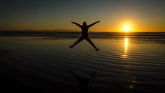 Sunset fun (Kathrin & Stefan) Tags: ocean sunset sky reflection beach nature silhouette backlight island sand outdoor tasmansea rakiura stewartisland foveauxstrait oretibeach