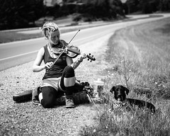 Fiddler and Dog (Lost in the Hills) Tags: ohio portrait blackandwhite dog playing female outdoors spring nikon flickr day moody exterior young naturallight clear thankful fiddle lonely appalachia smalltown absorbed sympathetic accomplished jacksoncounty landscapeformat d700 ohiofoothills lostinthehills romanwilshanetsky hockingvalleyphotographygroup