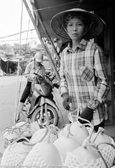 Melons anyone? (Pexpix) Tags: 400tx bw blackandwhite digitizedfilmnegative film kodakd76 kodaktrix400 leica35mmsummicronmf2asph leicampsilver market monochrome traders hanoi hni vietnam