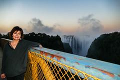 Patricia At Sunset (MarcCooper_1950) Tags: bridge sunset mist signs water river lumix waterfall dusk spray panasonic zimbabwe zambia plume lightroom livingstone southernafrica zimzam victoriafallsbridge vicoriafalls marccooper fz1000 royalivingstoneexpress