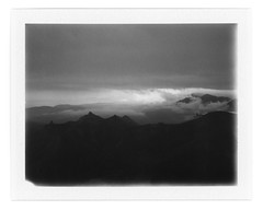 Cloudy evening near Sori Mountain (I) (Andrey Timofeev) Tags: camera sky bw white mist black mountains mamiya film nature monochrome misty fog clouds analog dark landscape polaroid blackwhite back haze mood view cloudy horizon foggy deep atmosphere rangefinder 100mm iso pack rainy land instant fujifilm universal analogue 3000 crimea vastness expiredfilm f35          mamiyasekor fp3000b               08may2015  usebefore201412