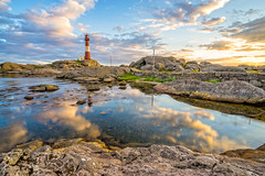The day fades at Eigeroy lighthouse (Richard Larssen) Tags: sunset sea sky sun seascape reflection nature norway zeiss landscape norge scenery sony norwegen unesco richard scandinavia fyr magma rogaland anorthosite fyrtrn geopark eigeryfyr egersund eigersund larssen eigery eigeroy eigerya emount anortositt richardlarssen eigeroyfyr eigerylighthouse sel1635z eigeroylighthouse