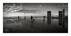 Viendo las olas pasar/ watching the waves roll in (Jose Antonio. 62) Tags: blackandwhite bw espaa reflection blancoynegro beautiful clouds spain gijn asturias nubes reflejo