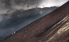 Up Mount Doom (Robert-Jan van Lotringen) Tags: etna vulcano sicily italy italia sicilia climb mountain clouds smoke ash rock dark mountdoom steep tourist travel cablecart gloomy moody grainy