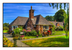 Owain Glyndr (Kevin From Manchester) Tags: wales llangollen cottage architecture flowers trees garden sky house clouds kevinwalker canon1855mm beautiful colorfull