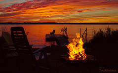 Aflame (Just Call Me Dave) Tags: sunset water summer night canada ontario efs1585f3556isusm clouds fenelonfalls