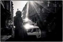 Sun & Nissan (stejo) Tags: woman sun spring nissan stockholm flare streetphoto curlyhair contrasts vår kontraster östermalm solstrålar kvinna voigtlander254 sunstrays lockigthår styckjunkargatan linsreflexer